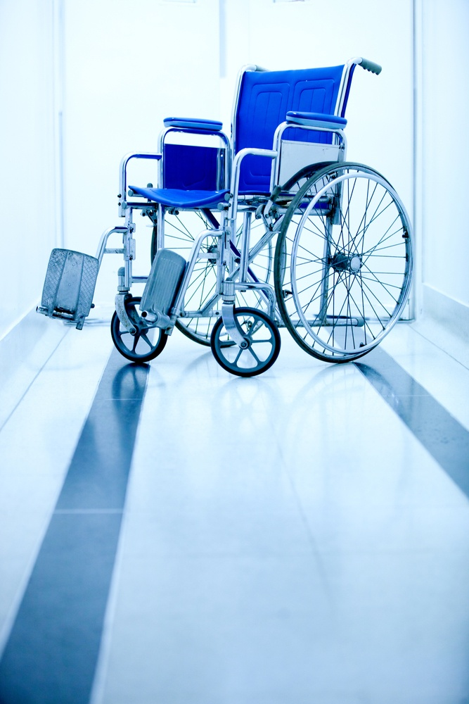 Blue wheelchair at the entrance of a hospital.jpeg