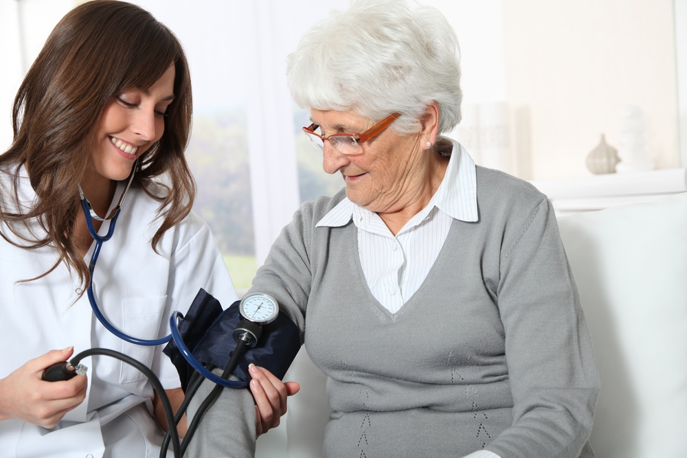Closeup of nurse checking senior woman blood pressure.jpeg